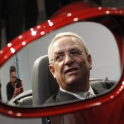 Martin Winterkorn, President and CEO of Porsche Automobil Holding SE is reflected in a mirror as he sits in a Porsche 911 Carrera Sports Car after the company's annual news conference in Stuttgart March 17, 2011. In its short fiscal year 2010 from August 01, 2010 to December 31, 2010, Porsche Automobile Holding SE generated group profit after tax of 1.286 billion euro.  REUTERS/Michaela Rehle  (GERMANY - Tags: TRANSPORT BUSINESS)